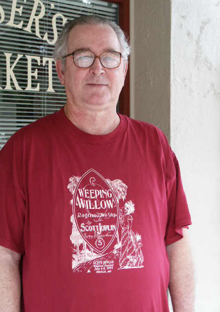 "Click on the ragtime fan to see this year's Theme Shirt featuring ""Weeping Willow""."